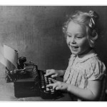 little-girl-pretends-to-write-on-a-typewriter